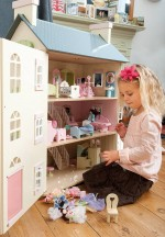 large dolls house with girl